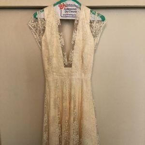 Beautiful tea length BHLDN Aaliyah wedding dress.